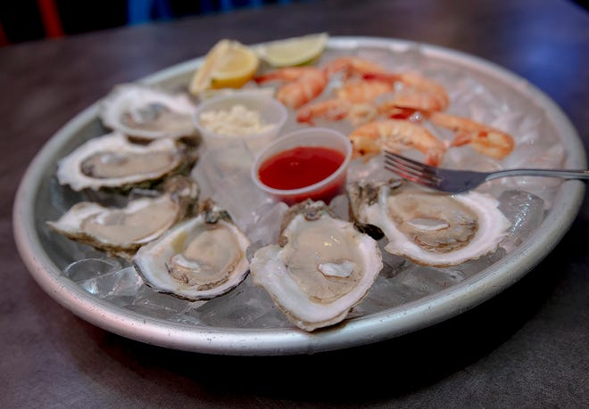 Get your oysters raw or broiled at two locations of Deckhand Oyster Bar.