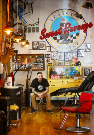 Adam Andrella opened his Sweet Revenge Tattoo Parlor in a Barberton storefront that was once an ice cream shop he frequented as a child.