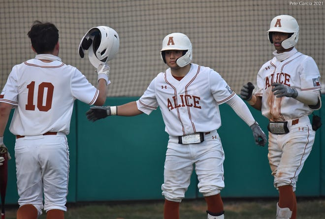 Alice baseball players celebrate during a District 31-4A game against Zapata in Alice.