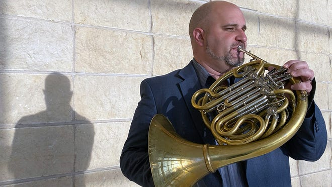 Guglielmo Manfredi, the university's professor of French horn, will be the featured guest soloist in Sunday's concert.