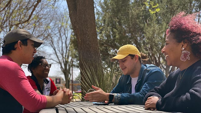 Environmental Science Society members Jason Velasquez, from left, Daisa Brown, Christian Campos and Damaris Washington plan hands-on activities for WT's Earth Day celebration.