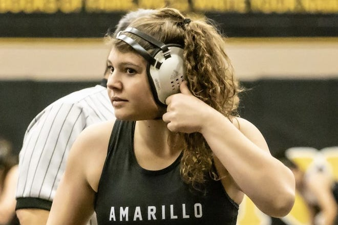 Amarillo High senior Faith Anderson unbuckles her chinstrap after a win last weekend at the District 3-5A meet.