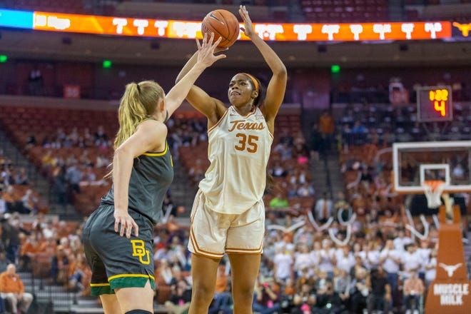Texas forward Charli Collier (35) looks to shoot over Baylor's Lauren Cox (15) in Austin on Jan., 31, 2020. Collier was selected with the first pick of the WNBA draft on Thursday.