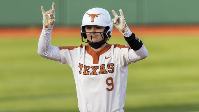 Texas shortstop McKenzie Parker celebrates a double against Texas Tech in Austin on April 1. She's hitting .415 this season, which is second on the team, and has entrenched herself as the starter at shortstop.