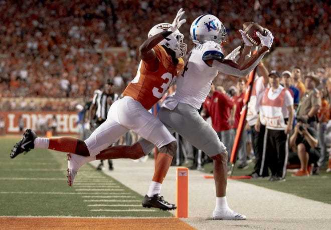 Kansas wide receiver Andrew Parchment catches a pass out of bounds as Texas linebacker David Gbenda defends during their 2019 game in Austin. Juwan Mitchell's transfer out has opened the door for Gbenda, who's looking to reset his career.