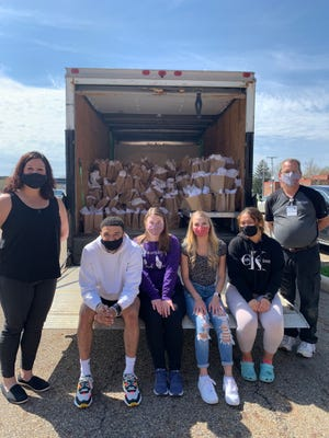 Abby Schroeder, from left, director of the Regula Center, and Mount Union students Logan Burns, Gina Hoffman, Abby Kimball and Riley Rowles show off a semi filled with thank-you bags for Aultman Alliance Community Hospital employees including Scott Foster, far right.