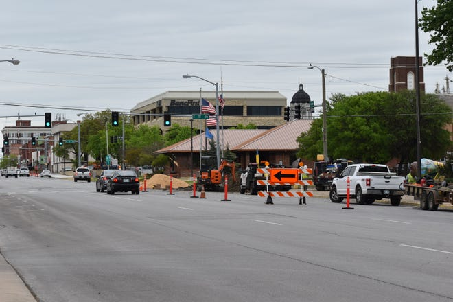 Orange cones and signs direct motorists away from utility work on West Main Street Thursday, April 15, 2021. City officials say Oklahoma Natural Gas is doing routine work to replace underground lines.