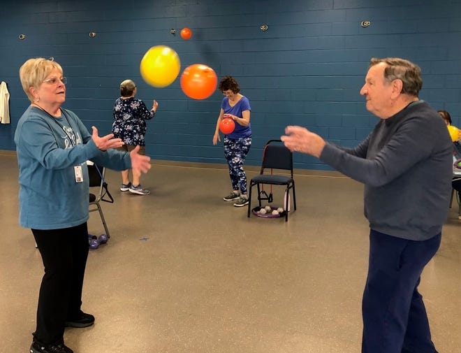 Herb and Frances Erhart practice hand-eye coordination during MSROM.