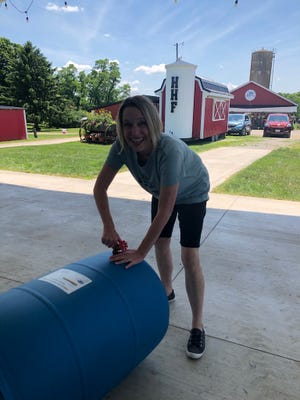 Christine Fisher from Loudonville works on her rain barrel during a previous rain barrel workshop.