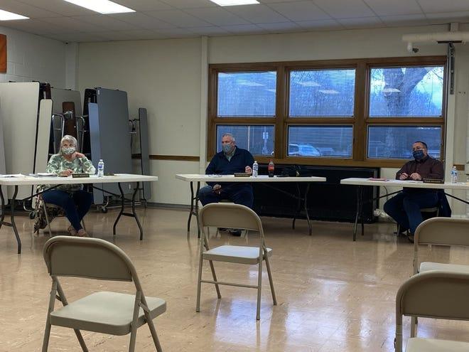 Black River School Board members listen to Superintendent Chris Clark at Thursday's meeting.