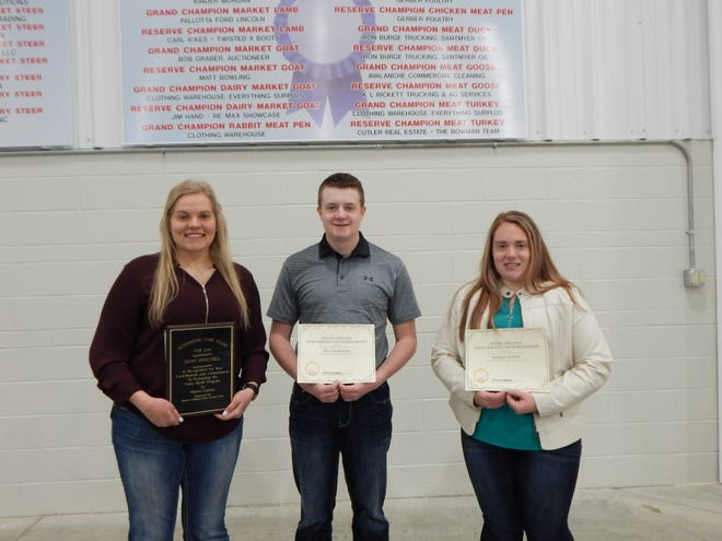 Scholarship recipients included, from left, Leah Winchel, also the Outstanding Dairy Youth, Tim Gunkelman and Morgan Gerhart with Elizabeth Howman, who was not present at the time of photo.