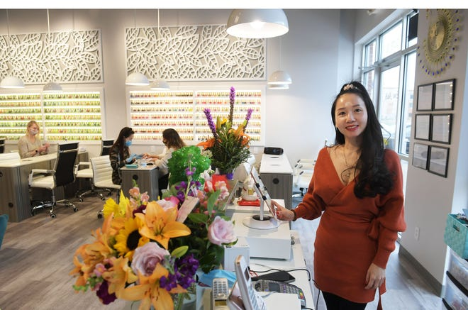 Uyen Murrell, the owner of the new Love Nails salon, poses at the salon Thursday, April 15, 2021, in Ames, Iowa.