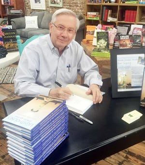 William Rawlings signs his latest book at Broad Street Books in Louisville.