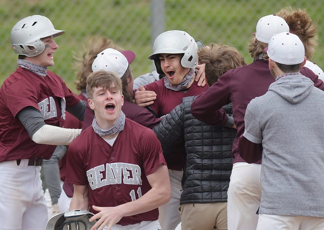 Beaver's Brooks Miller (center) is surrounded by teammates after hitting a walk-off home run during Thursday's game against New Castle at Hardy Field in Brighton Township.