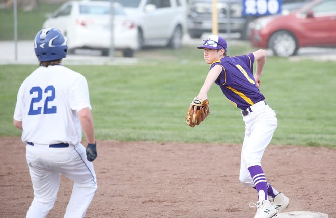 Pilot Grove shortstop Levi Jeffries attempts to turn a double play in the fifth inning Tuesday night in CAC action at New Franklin. The Tigers defeated New Franklin 14-8 to improve to 9-2 on the season.