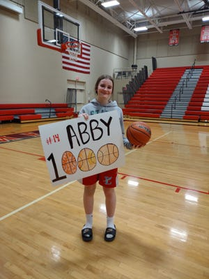 Abby Wiegand, an eighth grader at Lewistown Junior High, scored her 1,000th junior high career basketball point against Brimfield recently.