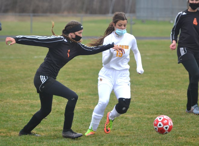 Cheboygan senior Tess Dunham (left) goes for the ball against Ogemaw Heights' Isabel Deerman during the first half of a varsity girls soccer matchup in Cheboygan on Wednesday.