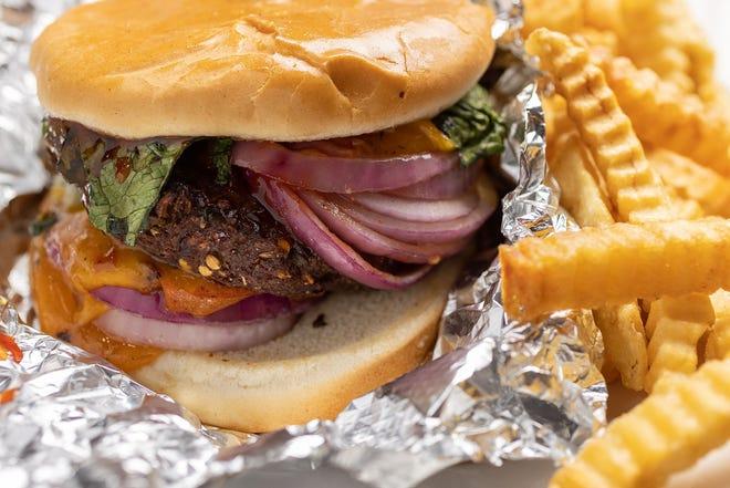 Chapli burger with fries at Jasmine Fusion Cuisine. (Jodi Miller)