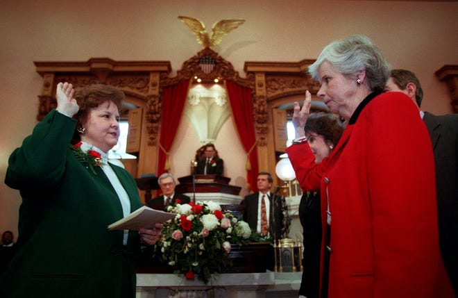 Ohio's first and only female House Speaker to date, Jo Ann Davidson, is sworn in for another term in early January 1997 by Ohio's first female Attorney General, Betty D. Montgomery, who also was the first woman to serve as state auditor. The two are good friends and still work together.