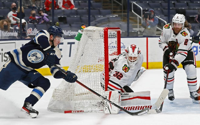 Blue Jackets center Alexandre Texier tries to score on Blackhawks goaltender Kevin Lankinen on Monday. Texier played 23:15 on 27 shifts in the game.