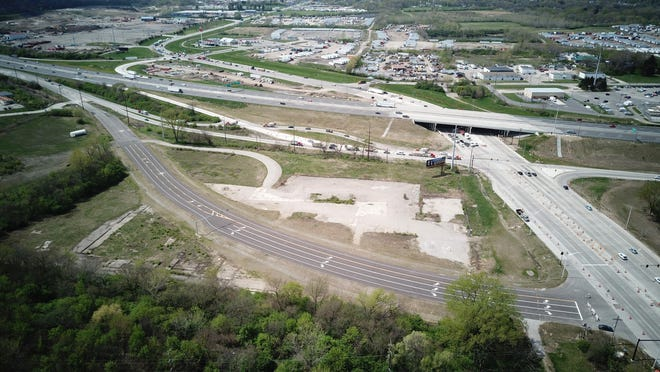 New lanes (foreground) are set to open on the I-71 and Frank Road interchange on the South Side. Frank Road is at right; I-71 is near the top of the picture. The concrete pad in the center was the site of the Inland Products complex, which rendered grease and used cooking oils from restaurants, along with animal carcasses.