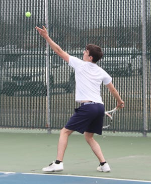 Erik Coauette serves during a match against Thief River Falls on Thursday, April 15. Coauette won two matches at No. 2 singles in a triangular at East Grand Forks on Friday.