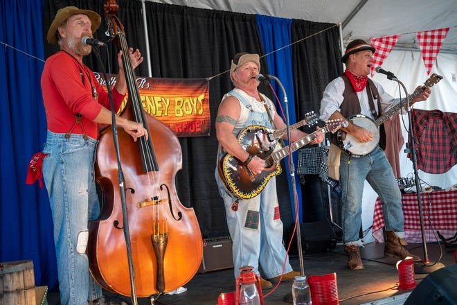 """""""Them Sweeney Boys"""" perform at the Lake County Fair twice a night with an extra show on the weekend. [Cindy Peterson/Correspondent]"""