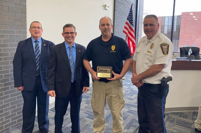 The Cambridge Police Department hosted a retirement ceremony for detective Greg Clark n Thursday. Pictured at the ceremony are, from left, Cambridge Safety Director Rocky Hill, Mayor Tom Orr, Clark and Police Chief Mark DeLancey.