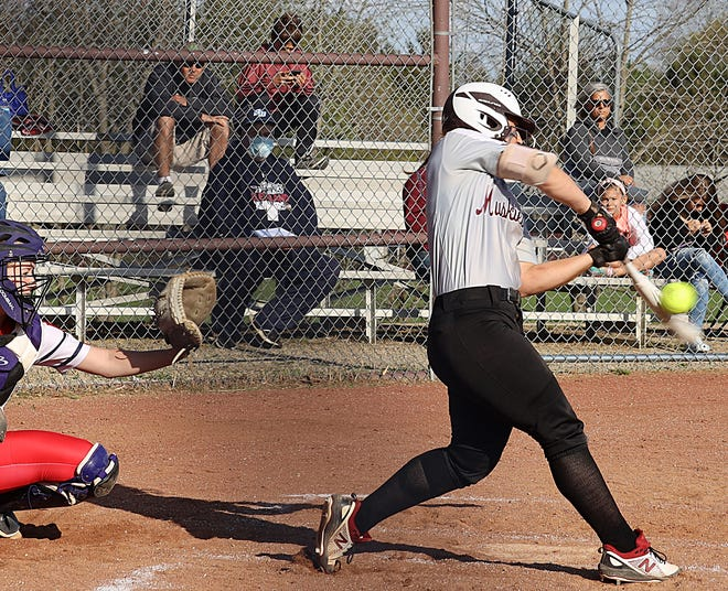 John Glenn sophomore lead-off hitter Hannah Bendle (12) turns on a pitch during Wednesday's 5-1 victory over visiting Indian Valley. The Lady Muskies collected a 5-1 win to improve to a perfect 13-0 mark on the season.