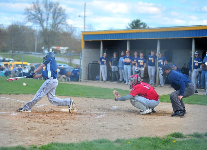 "Hillsdale's Jake Hoverstock takes a swing against Norwayne as his teammates watch in the background Wednesday at PNC Fields in Wooster. The Falcons are playing all of their ""home"" games in Wooster this season because their field in Jeromesville is under construction."