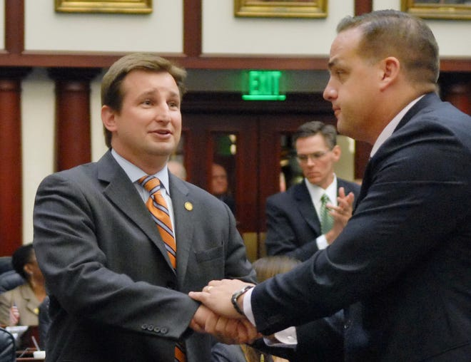 Frank Artiles, R-Miami, congratulates Jason Brodeur, R-Sanford, on March 22, 2013, when both were members of the Florida House of Representatives. Artiles is charged in connection with an election fraud case in South Florida, while parallels can be found in Brodeur's election to the Senate last November.