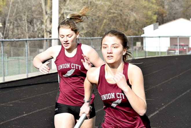 Union City's Adah Gaborik hands off to teammate Ivey Parnell during the 800 meter relay versus Athens Wednesday.