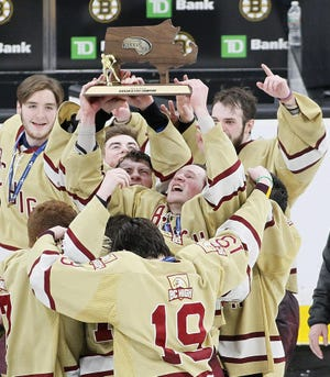 Boston College High School hockey players celebrate after beating Pope Francis in the fourth overtime period of the Super 8 final at the TD Garden on Sunday, March 17, 2019.