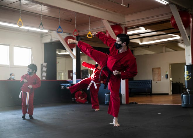 Sensei Kenny, Kenneth Garcia, 49, goes over kicks with his yellow belt karate students during the kids class at Kenny's Karate School in Brockton at 60 Skinner St. on Wednesday, April 14, 2021.