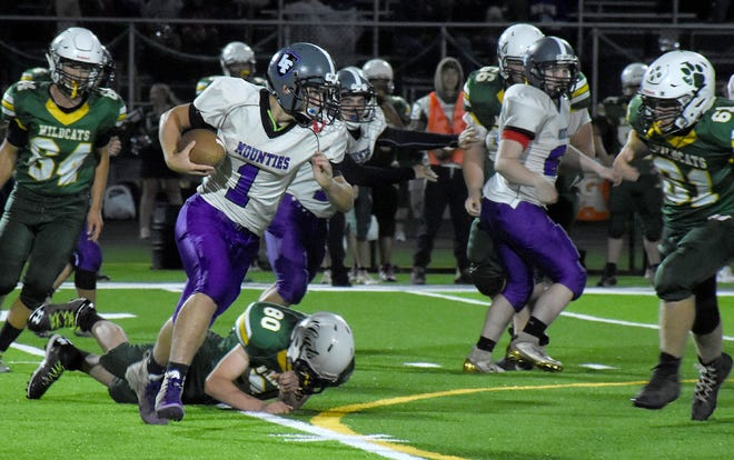 Little Falls Mountie Cole Cleary runs the ball against Adirondack Sept. 19, 2019, during the first game played under the lights at the newly turfed field in Boonville. Cleary and the Mounties will play under their own lights for the first time Saturday.