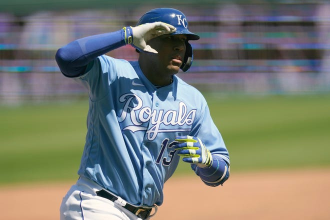 Kansas City Royals Salvador Pérez salutes while rounding the bases after slugging a solo home run in the third inning of Wednesday's game at Kauffman Stadium. Pérez also doubled to help the Royals to a 6-1 win over the Los Angeles Angels and finished the three-game series by going 8-for-12.