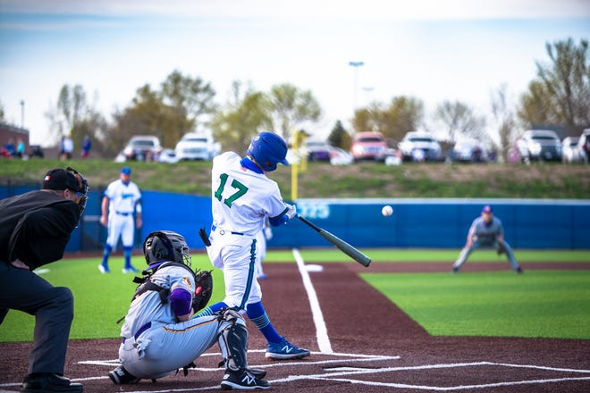 Blue Springs South's Grant Hollister (17) strokes a two-run double in the fifth inning of Wednesday's game against rival Blue Springs. Hollister also singled and drove in four runs to help the host Jaguars to a 7-2 victory.