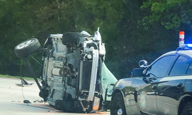 A mangled car lies on its side on Interstate 95 after a deadly five-vehicle March 20 crash near Airport Road in Jacksonville.