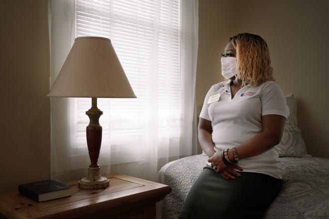 Natalie Marcano-Sidberry, a case manager for Northeast Florida Women Veterans, sits in one of the upstairs bedrooms at HerSPACE, the nonprofit's new temporary shelter for Florida women veterans and their children. Marcano-Sidberry was once homeless herself.