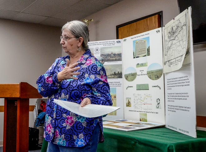 """Linda Peters, president of the Wagon Bed Springs Chapter of the Santa Fe Trail Association, talks about the Santa Fe Trail at the final """"History at High Noon"""" event, hosted by the Finney County Historical Society and Museum on Wednesday."""
