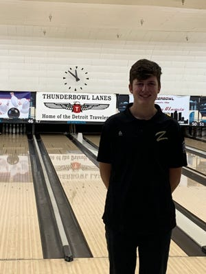 Grant Bush poses in front of a lane at the individual state finals