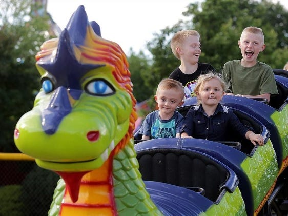 A group of kids enjoy the dragon rollercoaster at the Brewster Firemen's Festival. Officials have canceled this year's event amid concerns about the rising cases of COVID-19 and being able to meet social distancing requirements.