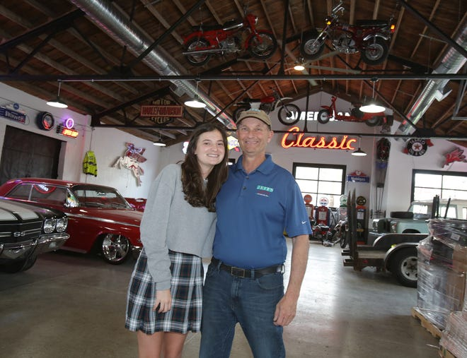 Chloe Doll (left) and her father, Jeff, owner of Jeff's Motorcars Inc., are opening Chloe's Diner on Massillon's northeast side. The new eatery is to feature classic vehicles and unique decorations, many of which are from the 1950s, '60s and '70s.