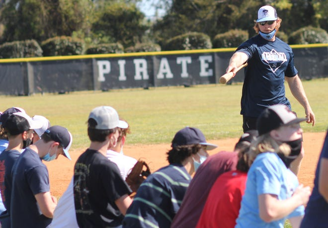 Swansboro baseball coach Adam Daley talks to his team during a recent practice. [Chris Miller / The Daily News]