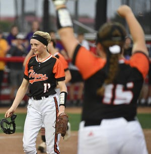 Kiersten McCoy of Illini Bluffs walks off the field after a victory in a 2019 Class 1A supersectional at Louisville Slugger Complex in Peoria.