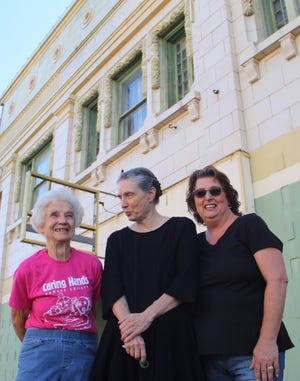 From left, Cath Weems, owner of the Sunflower Theatre; Susan Mayo of Peabody and Marilyn Jones of Peabody have been renovating the more that 100-year-old Sunflower Theater in Peabody,