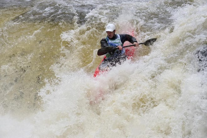 Eric Bartl  paddles through whitewater conditions on the Cuyahoga River at a past Cuyahoga Falls Fest event.