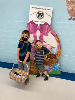 Haught brothers, Graham and Lucas, find their last goody-filled egg during the St. Joseph Parish Egg Hunt Open House, which was held for families with students in preschool, PreK, and Kindergarten.