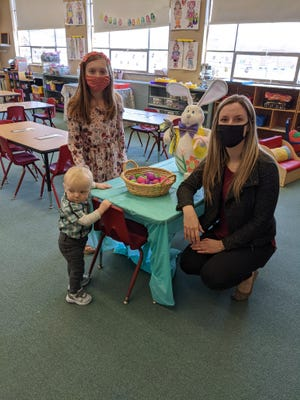 St.  Joseph Parish Preschool Administrator Kelsey Herideen visits with Sophia and Thomas Dapp, at the school's Egg Hunt Open House that took place before Easter.