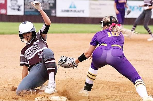 Merryville's Lindsey Townsley (left) slides in safely under the glove of South Beauregard's Marlee Fontenot (10) during the Lady Panthers' win over the Lady K's on Tuesday, 9-8.